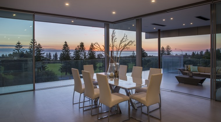 Drinking in the view  indoors become outdoors apartment, architecture, condominium, estate, home, house, interior design, living room, penthouse apartment, property, real estate, window, gray, black