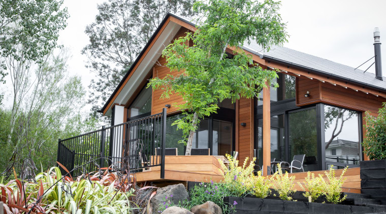 This home by Dwelling Architectural Design takes its architecture, backyard, cottage, facade, farmhouse, home, house, property, real estate, siding, yard, white