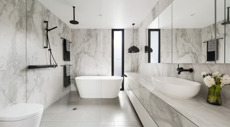 Large format, marble-look porcelain tiles contribute to the architecture, bathroom, floor, flooring, home, interior design, plumbing fixture, product design, room, tap, tile, gray