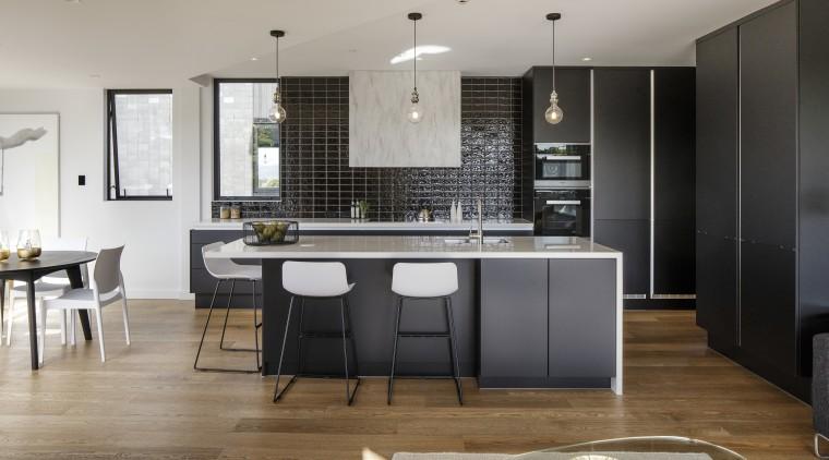 Dark cabinetry surfaces in this kitchen work well countertop, floor, flooring, interior design, kitchen, room, gray, black