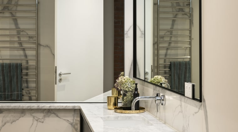 Large-format porcelain wall panels with a rich vein countertop, floor, interior design, room, window, gray