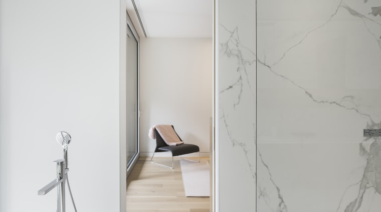 This vacation home has long slender plan, with floor, glass, interior design, product design, tap, wall, gray, white