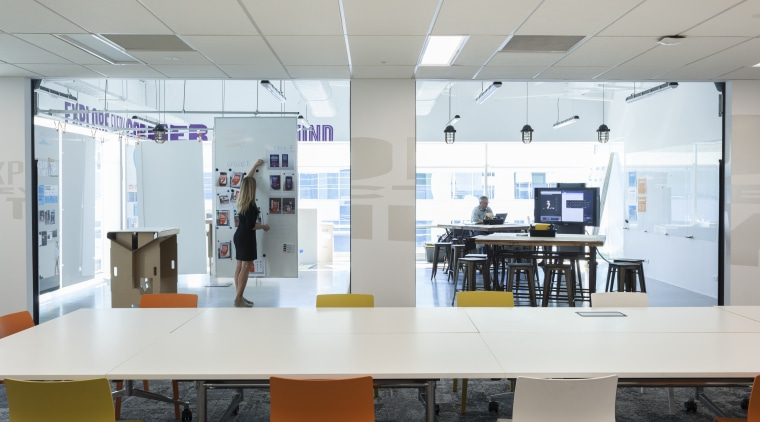 Designed by Chantal Gaiqui of Stack Interiors, The institution, interior design, office, product design, gray, white