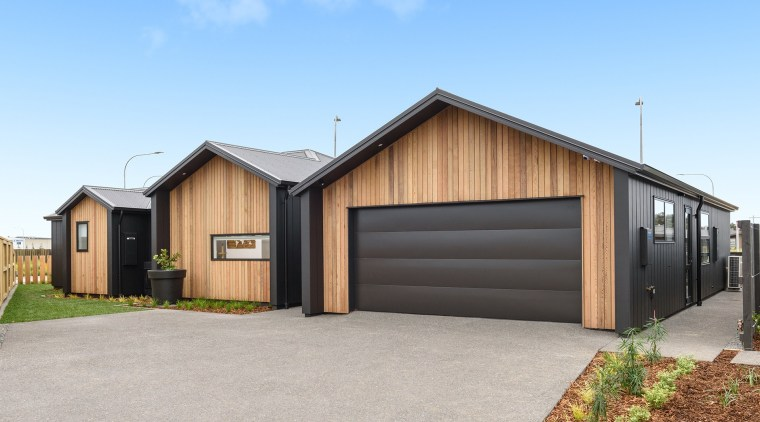 6 Hoiho Place Exterior building, facade, garage, home, house, property, real estate, shed, siding, teal, gray