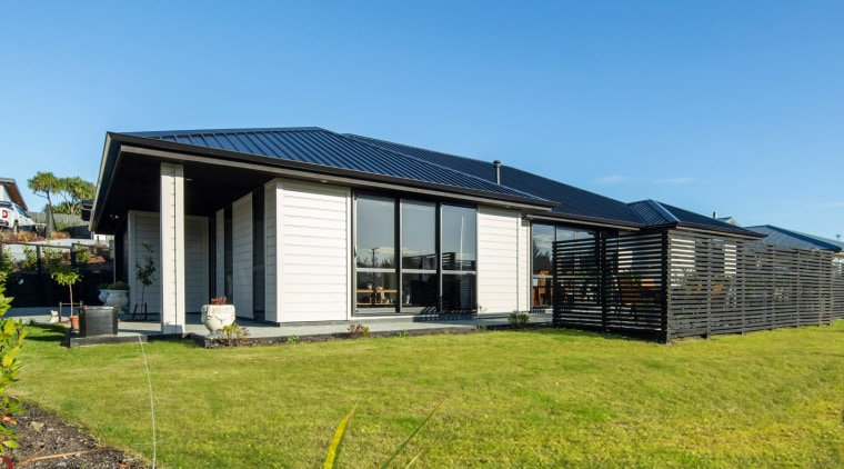 Envira Rusticated Weatherboard Home In Otago cottage, facade, home, house, property, real estate, teal