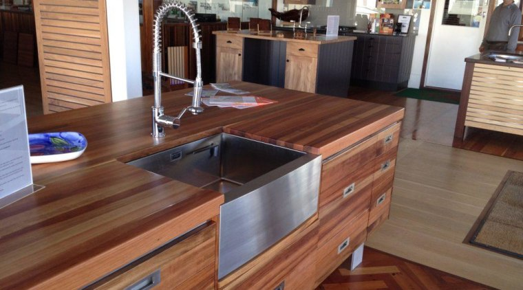 Stainless steel is a timeless look, and can cabinetry, countertop, cuisine classique, floor, flooring, furniture, hardwood, kitchen, laminate flooring, wood, wood flooring, wood stain, brown