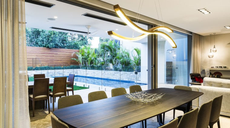 Connected to the combined living, kitchen, dining space ceiling, dining room, interior design, real estate, table, window, white