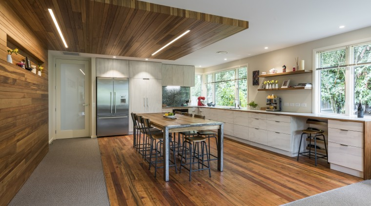 This major renovation places a strong emphasis on countertop, floor, flooring, hardwood, house, interior design, kitchen, real estate, room, wood, wood flooring, gray, brown