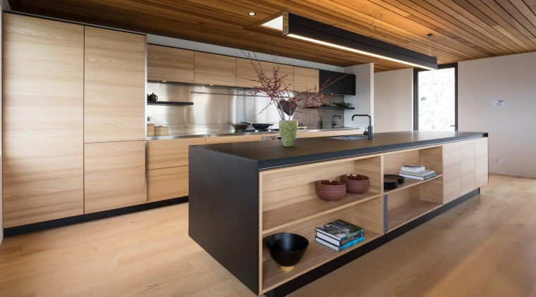 Part of the calm, restful appeal of this architecture, cabinetry, countertop, cuisine classique, floor, flooring, hardwood, house, interior design, kitchen, real estate, wood, wood flooring, brown