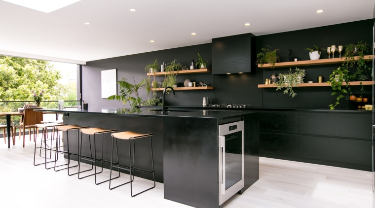 Paint choices help downplay on-view kitchen's functionality countertop, interior design, kitchen, white, black