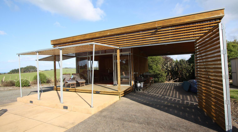 With all the awnings up and doors slid canopy, house, outdoor structure, pergola, property, real estate, roof
