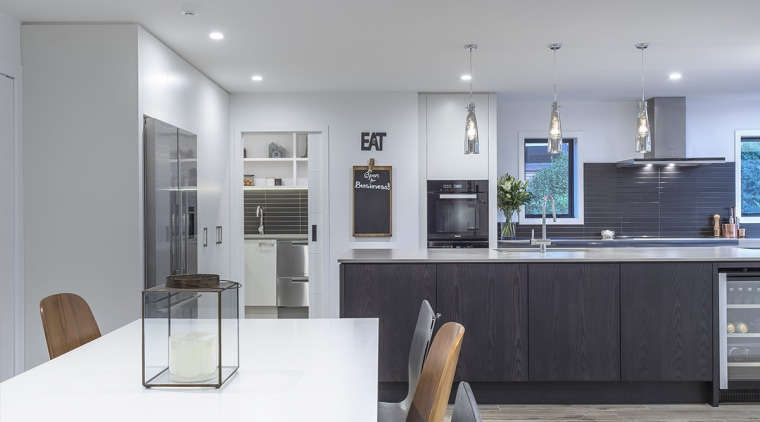 In this sleek kitchen project by designer Kira architecture, countertop, interior design, kitchen, gray