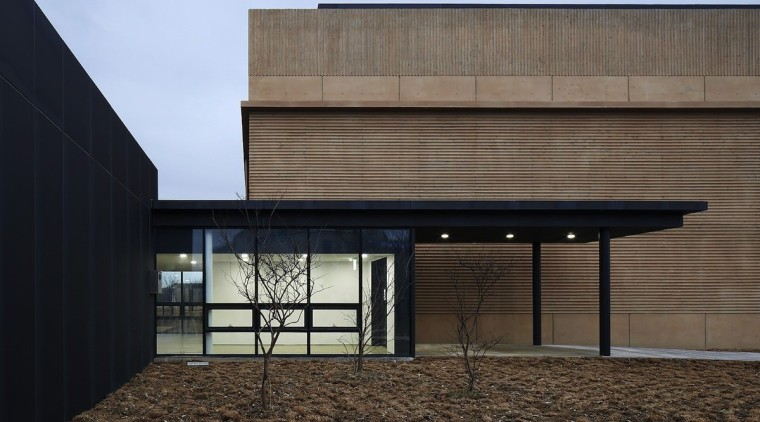 The lobby is welcoming, with floor to ceiling architecture, building, daylighting, facade, house, black