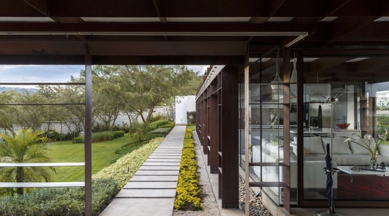 A tidy pathway runs down the side of architecture, house, real estate, black, gray