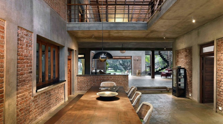 The upper level looks down onto the large ceiling, courtyard, daylighting, estate, interior design, living room, lobby, brown