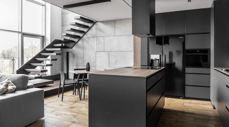 Metal, concrete, floral wood and graphite appear throughout cabinetry, countertop, cuisine classique, floor, interior design, interior designer, kitchen, loft, product design, black, white