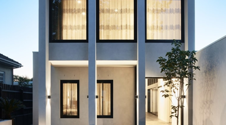 At dusk, the large black-framed windows come into architecture, building, elevation, estate, facade, home, house, property, real estate, residential area, siding, sky, villa, window