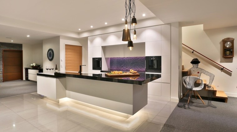Recessed lighting makes the island look like it's fireplace, floor, hearth, interior design, living room, real estate, gray
