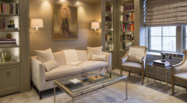 The focus is certainly on the painting in couch, floor, flooring, furniture, home, interior design, living room, room, wall, brown