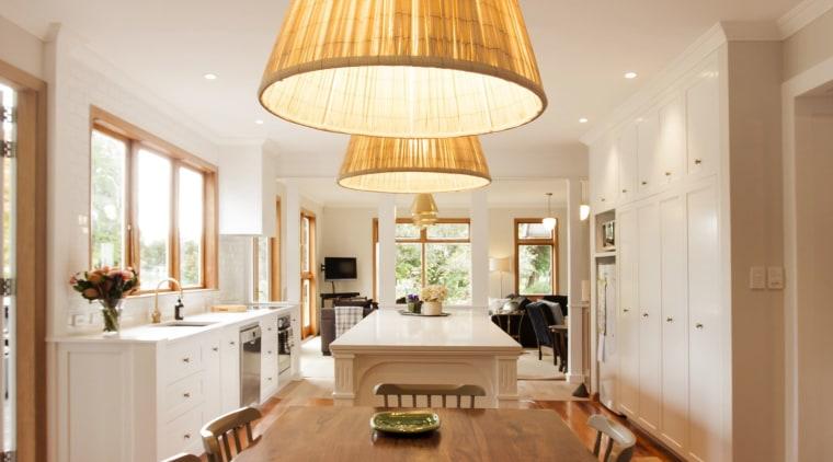 TIDA NZ 2017 – Designer kitchen entrant – ceiling, chandelier, dining room, floor, flooring, hardwood, interior design, laminate flooring, light fixture, lighting, living room, table, wood, wood flooring, orange, brown