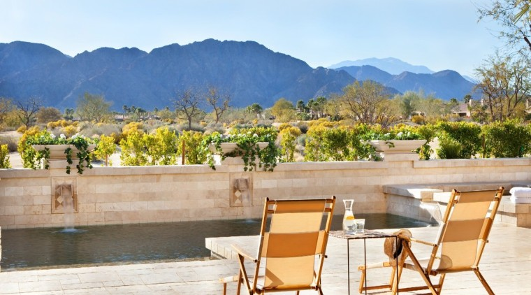 There's no better place to unwind after a estate, home, landscape, outdoor structure, property, real estate, resort, table