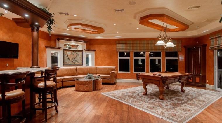 In the living room of a traditional British ceiling, floor, flooring, hardwood, interior design, living room, real estate, room, wood, wood flooring, brown, orange