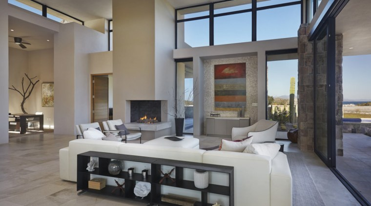 The living area faces out to the beach floor, interior design, living room, real estate, window, gray
