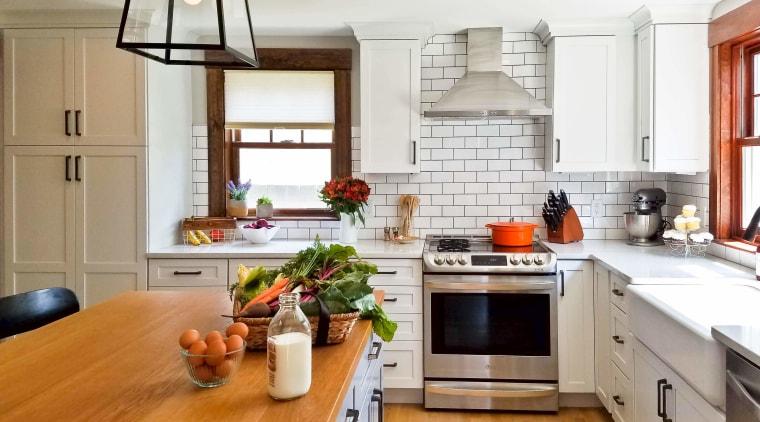White, NY deli-like tiles form the splashback and cabinetry, countertop, cuisine classique, floor, flooring, hardwood, home, interior design, kitchen, laminate flooring, living room, room, wood flooring, white