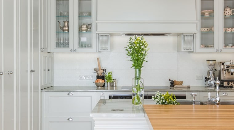 The layered island is certainly an interesting touch cabinetry, ceiling, countertop, cuisine classique, floor, home, interior design, kitchen, room, wall, window, gray