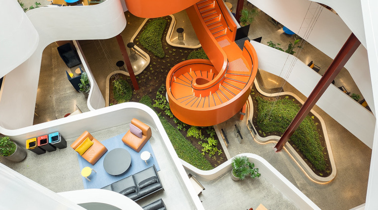 The vibrant, spiral staircase in the atrium of white