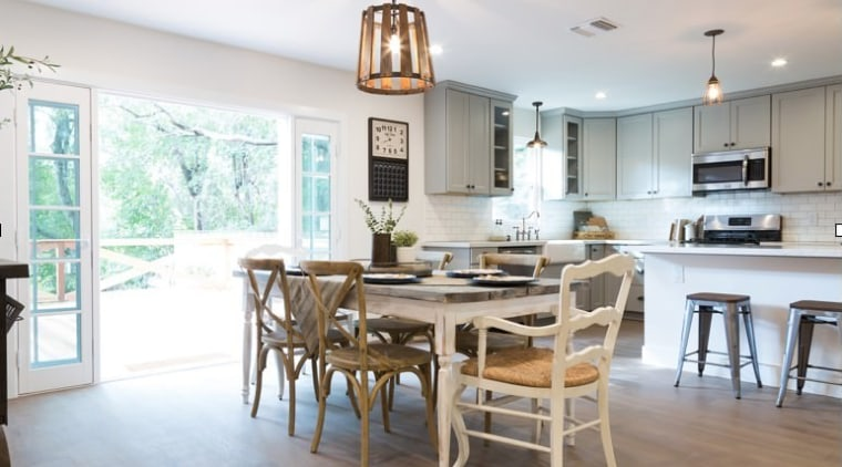 The farmhouse stylings meet more contemporary touches in chair, countertop, cuisine classique, dining room, furniture, home, interior design, kitchen, real estate, room, table, white