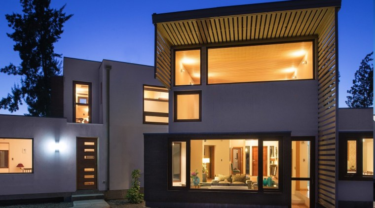 The front of the home is certainly quite architecture, building, elevation, estate, facade, home, house, lighting, property, real estate, residential area, window, black