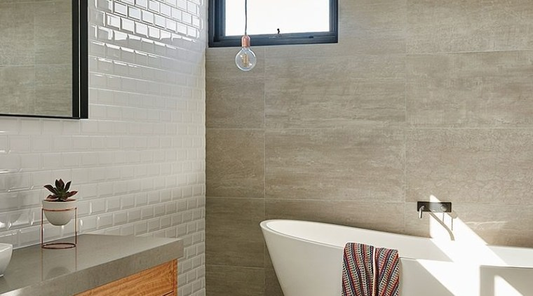 White tiles behind the vanity balance out the architecture, bathroom, floor, flooring, home, interior design, plumbing fixture, room, sink, tap, tile, wall, wood flooring, gray