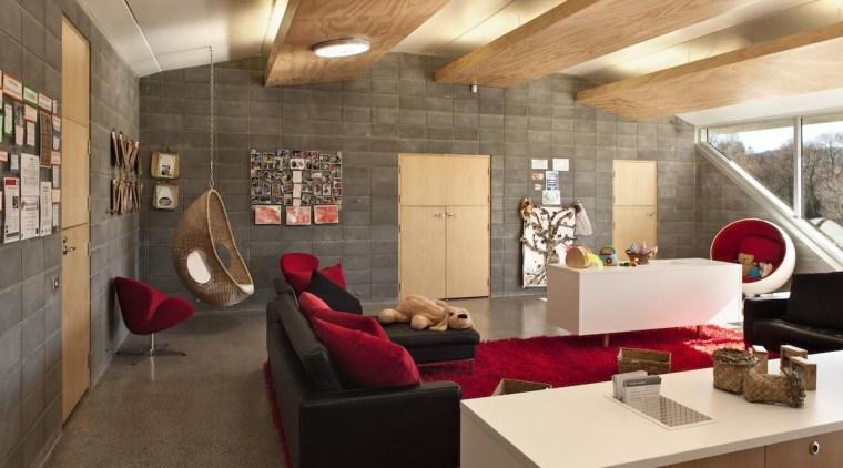 Te Mirumiru, a bilingual childcare center in New ceiling, furniture, interior design, living room, lobby, loft, brown, orange