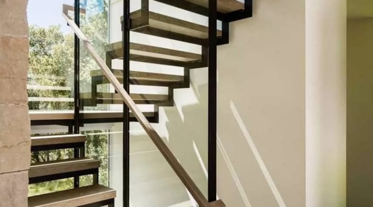 The stairs in this new home by Feldman glass, handrail, stairs, structure, gray