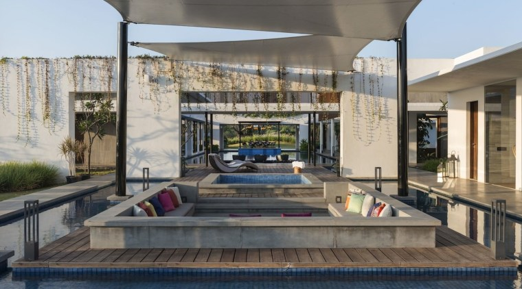 A sunken seating area outside receives shelter from real estate, gray
