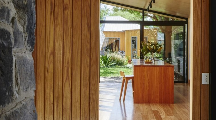 Planks run from the tile floor to meet architecture, door, floor, flooring, hardwood, home, house, interior design, laminate flooring, real estate, wall, wood, wood flooring, wood stain, brown