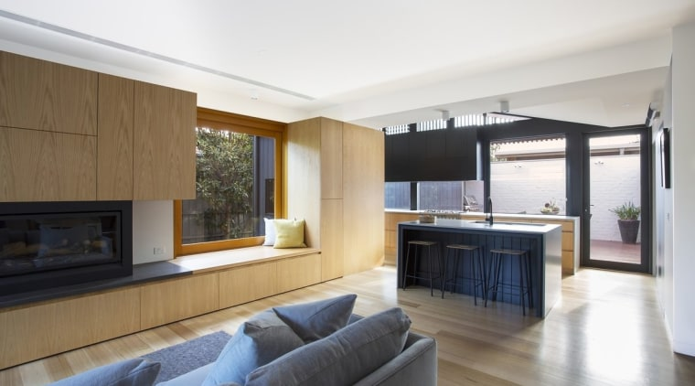 The lounge flows into the kitchen. The window architecture, floor, house, interior design, living room, property, real estate, window, white