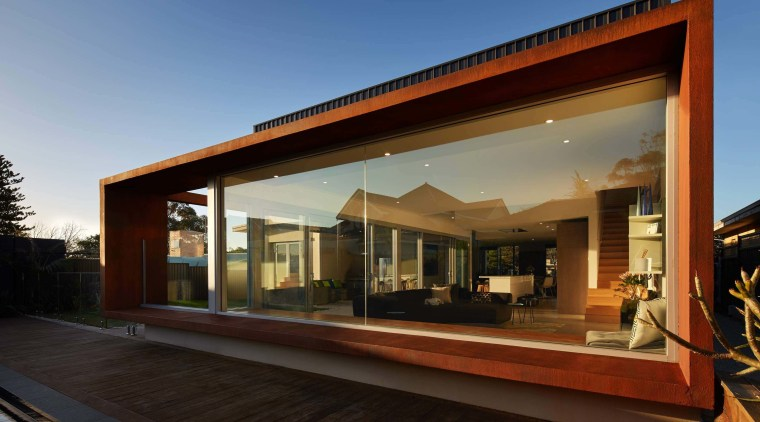 Weathering steel frames this window architecture, facade, home, house, property, real estate, window