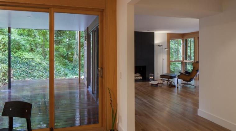 A view down into the lounge door, estate, floor, flooring, hardwood, home, house, interior design, laminate flooring, living room, property, real estate, room, window, wood, wood flooring, brown, gray