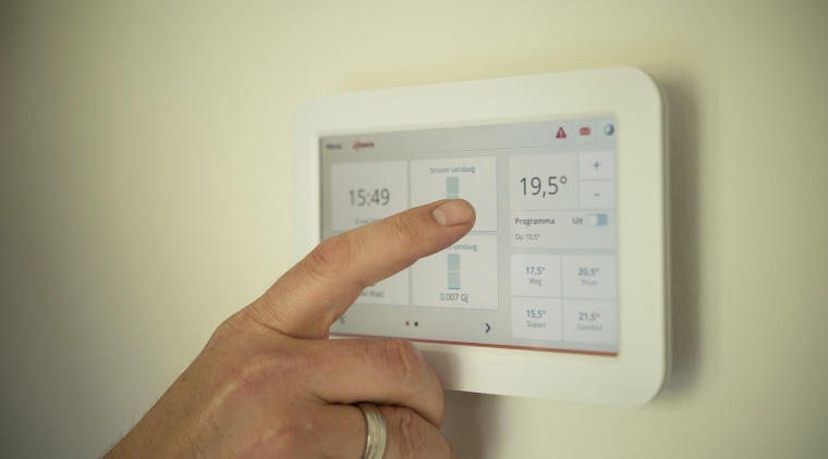 Keep your heaters on low to save energy electronic device, electronics, finger, hand, product design, technology, yellow, brown