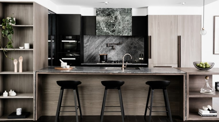 A stone splashback and rangehood compliment the wood cabinetry, countertop, cuisine classique, interior design, kitchen, black, white, gray