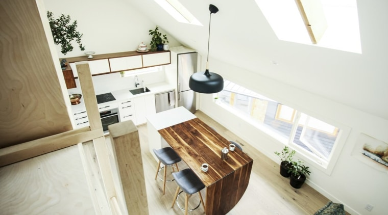 The dining table extends out from the island floor, furniture, hardwood, home, house, interior design, product design, real estate, room, table, wood, white