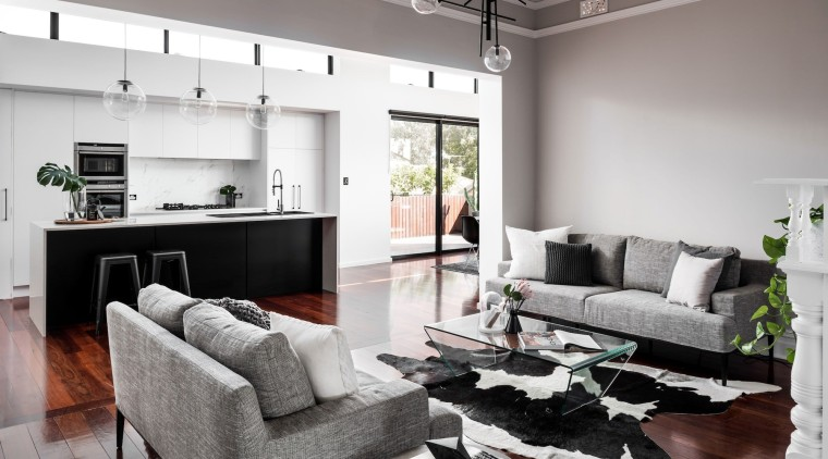 The living space is large and open, with floor, furniture, home, interior design, living room, property, real estate, room, white, gray