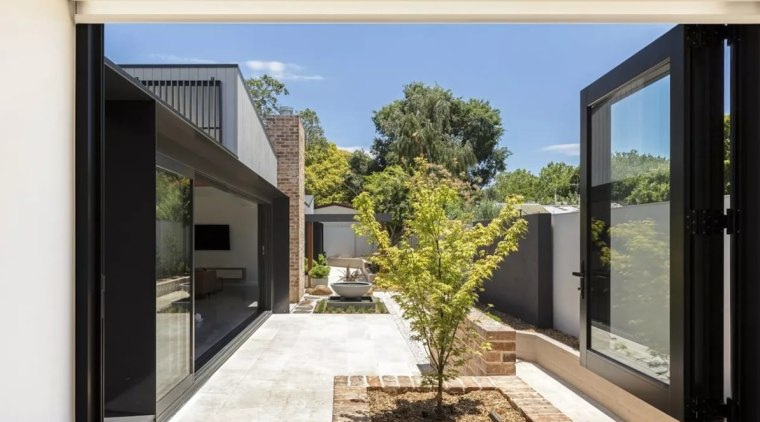 With space at a premium in the suburbs, architecture, courtyard, door, facade, home, house, interior design, property, real estate, window, white, black
