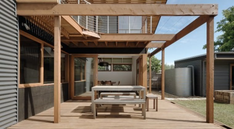 Wood slats line the upper level of this architecture, deck, elevation, facade, house, outdoor structure, real estate, residential area, siding, brown