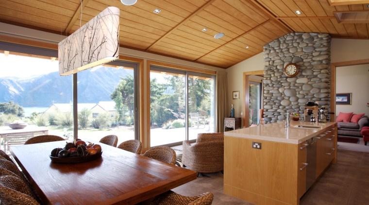 Beautiful mountain views. ceiling, estate, hardwood, home, house, interior design, living room, real estate, room, window, wood, brown
