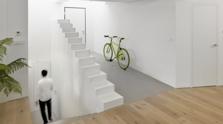 This stairway runs counter to a potential shelf floor, flooring, house, interior design, laminate flooring, product design, wall, wood, wood flooring, gray
