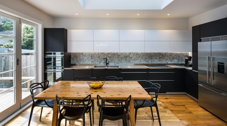 A substantial skylight sits above the kitchen countertop, interior design, kitchen, real estate, room, gray