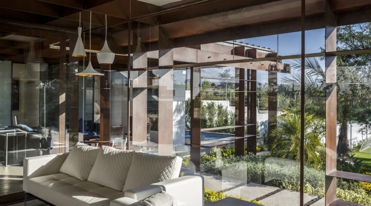 Steel is on full display throughout the home house, interior design, property, real estate, window, black, gray